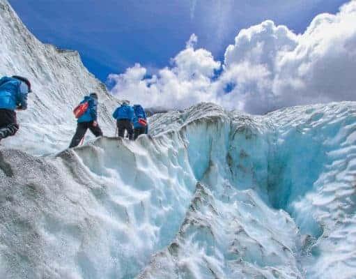 climbers climbing high mountain