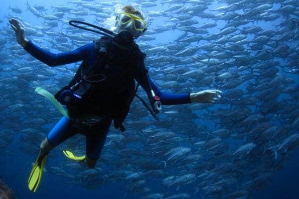 man scuba diving alone